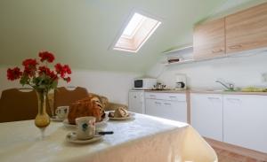 Haus Primosch - Ferienwohnung - Küche mit Kärntner Reindling