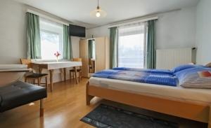 Haus Primosch - Schlafzimmer in der großen Ferienwohnung